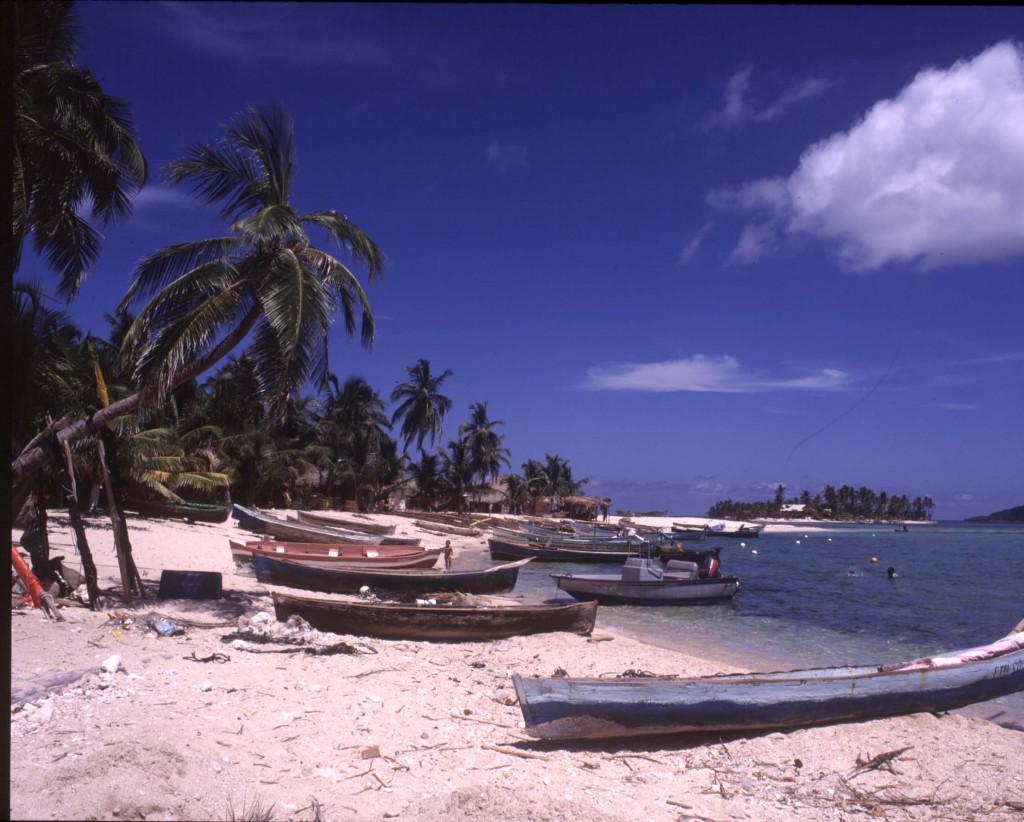 Beach and fishing boats at Garifuna Village in Chachahuate Cay, Cayos Cochinos